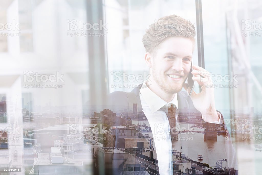 double exposure of business man talking by phone stock photo