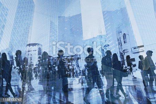 istock double exposure of business people walking on the street 1155133747