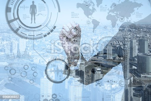 istock double exposure of business person and various information GUI 696806932