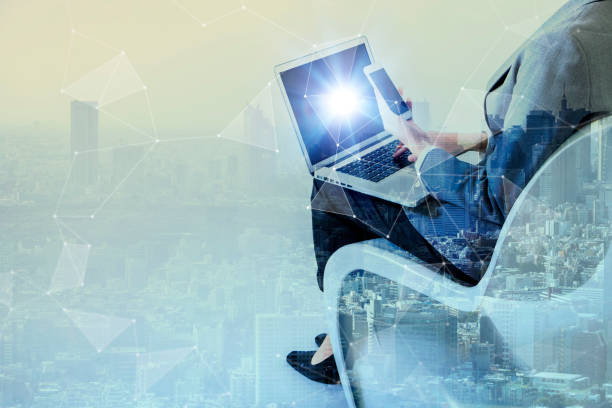 double exposure of business persons holding tablet pc and modern cityscape, internet of things(iot) conceptual abstract - laptop digital composite stock photos and pictures