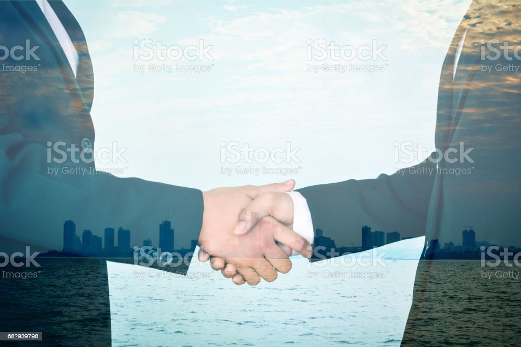 Double exposure of business shake hand in building background royalty-free stock photo