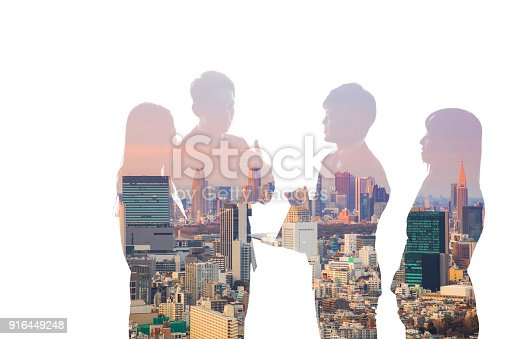 istock Double exposure of business team and urban cityscape. 916449248