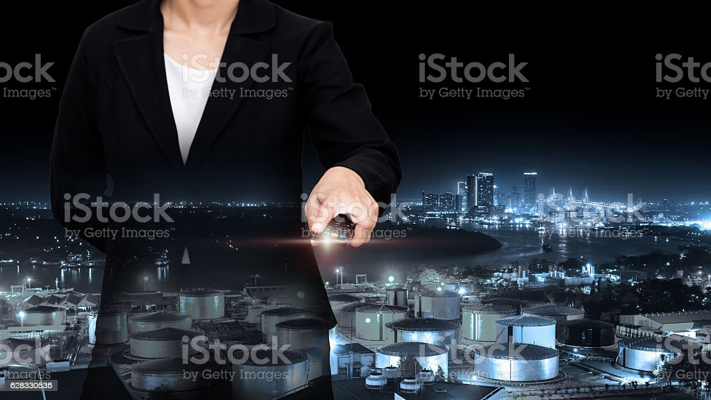 Double exposure of business with night refinery blurred backgrou stock photo