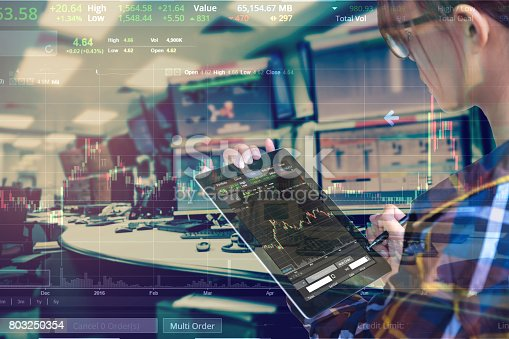 istock Double exposure of business woman with glasses in hipster shirts holding tablet for check stock market graph with stock and computer graph background, Business Trading concept. 803250354