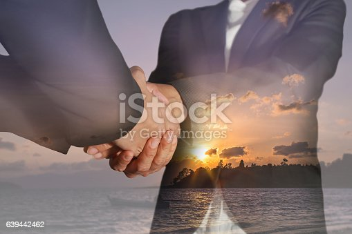 istock Double exposure of business women double handshake and sunrise beach 639442462