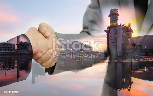 istock Double exposure of business women double handshake 639951582