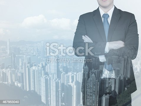 1079450712 istock photo Double exposure of businessman and city 467953040
