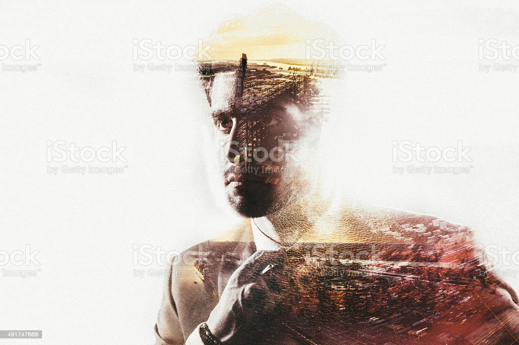Double exposure of businessman and port city with subtle colour stock photo