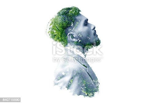istock Double exposure of businessman and tree 840715590