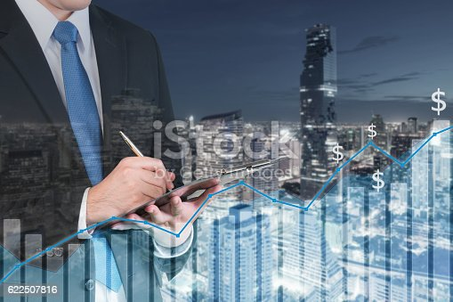 611747524istockphoto Double exposure of businessman booking with city and financial 622507816