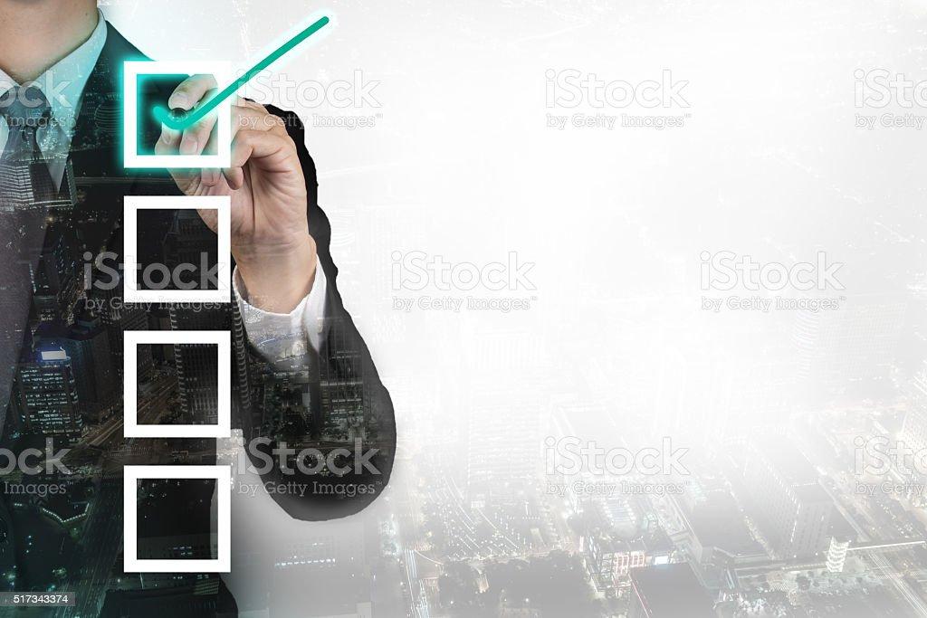 Double exposure of businessman check list.concept stock photo