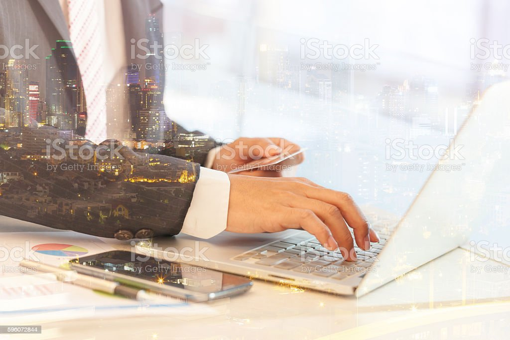Double exposure of businessman doing online banking. royalty-free stock photo