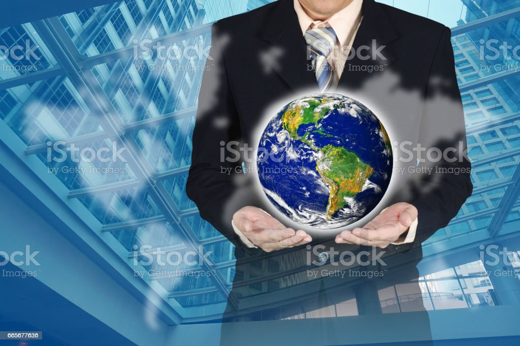 Double exposure of businessman holding earth planet with financial graph chart and world map on city background stock photo