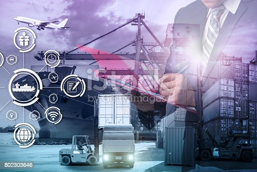 istock Double exposure of Businessman in a suit signing or writing a document in front Industrial Container Cargo freight ship 802303646