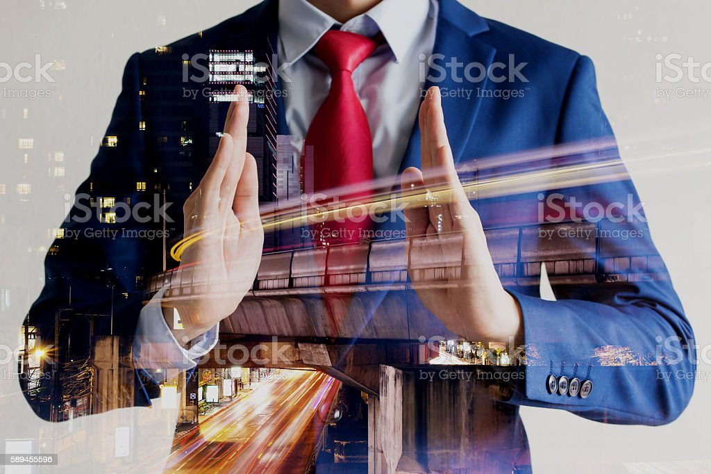 Double exposure of businessman in protecting position with night stock photo