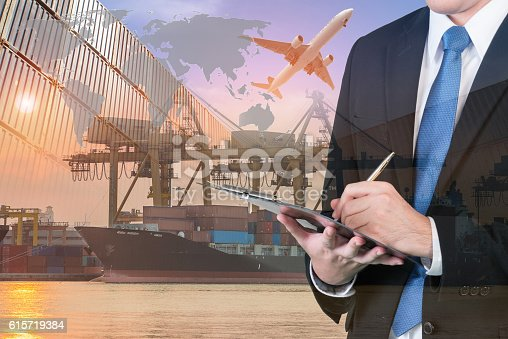 istock Double exposure of businessman is booking with blurred cargo 615719384