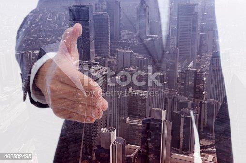 istock Double exposure of businessman offering handshake 462582495