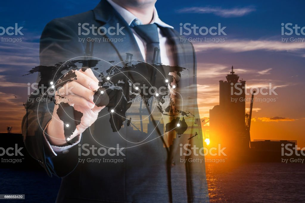 Double exposure of businessman touch screen on map to transport products at logistics port background, transportation trading business concept, world map element of this image furnished by NASA royaltyfri bildbanksbilder