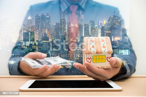917307226istockphoto Double Exposure of businessman using tablet with city night 962791008