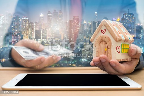 917307226istockphoto Double Exposure of businessman using tablet with city night 962791014