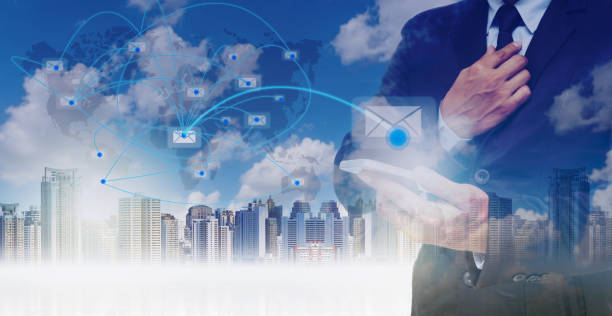 double exposure of businessman using the tablet for sending the email on world map with network line over the cityscape background, business concept,elements of this image furnished by nasa - petticoat stock pictures, royalty-free photos & images