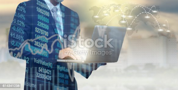 611747524istockphoto Double exposure of businessman using the tablet with Stock market 614341238