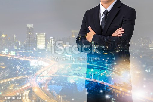 Double exposure of businessman with cityscape and globalization network, Business innovation and technology concept
