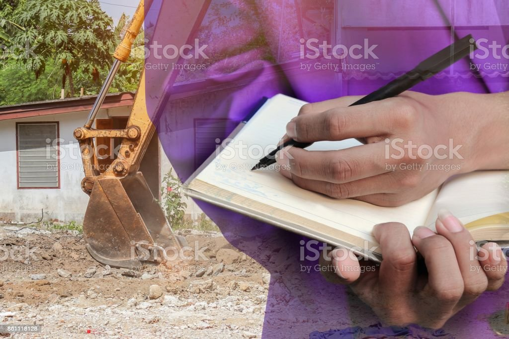 Double exposure of businessman  with notepad in hand signing documents in construction  site workplace concept. stock photo
