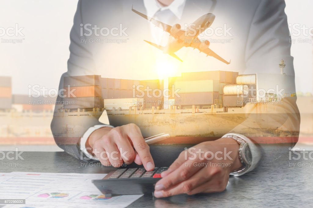 Double exposure of businessman working with calculator, Container Cargo ship, Cargo plane and airplane take off at sunset as business, Calculation, industrial, transportation and import export concept stock photo