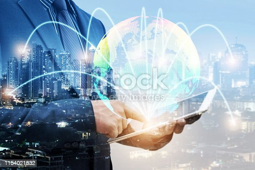 938918098 istock photo double exposure of businessmen using laptop with blur city night and network connection concept 1154021832