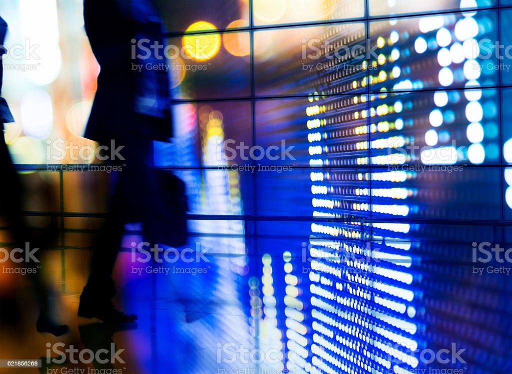 Double exposure of businesspeople walking - Photo