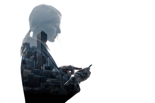 Double exposure of businesswoman and building exterior. stock photo