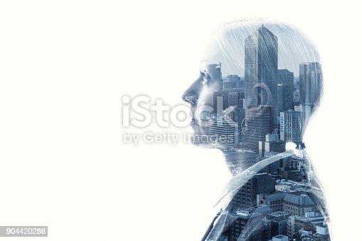 916376282 istock photo Double exposure of businesswoman and cityscape. 904420286