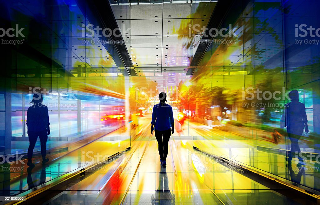 Double exposure of businesswoman silhouette walking into the lig stock photo