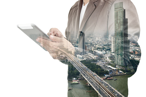 635942136 istock photo Double exposure of city and Businessman use Tablet device 493278460