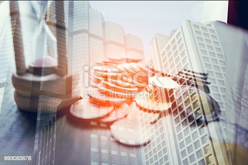 821678930 istock photo Double exposure of city and rows of coins on book bank for finance and banking concept 693063676