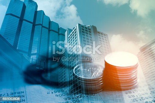 821678930 istock photo Double exposure of city and rows of coins on book bank for finance and banking concept 693063808