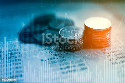 821678930 istock photo Double exposure of city and rows of coins on book bank for finance and banking concept 693063846