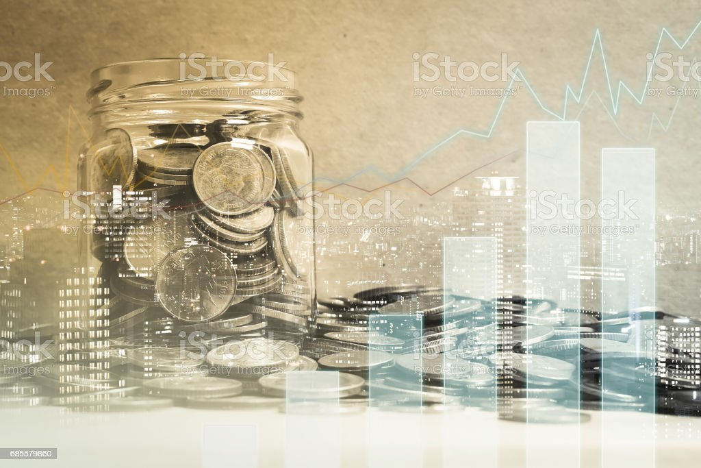 Double exposure of city, graph and coins in the bottle for finance and banking concept royalty-free 스톡 사진