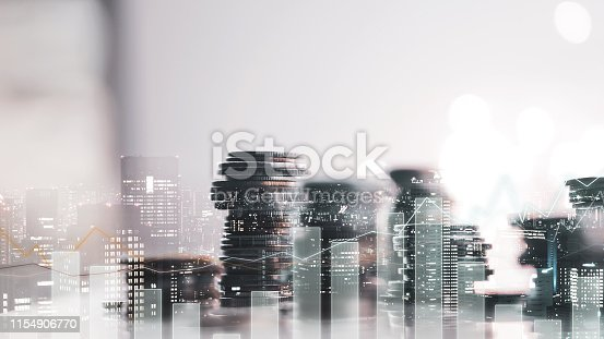 istock Double exposure of city view. diagram graph and rows of money coins for finance , money , investment and business concept background 1154906770