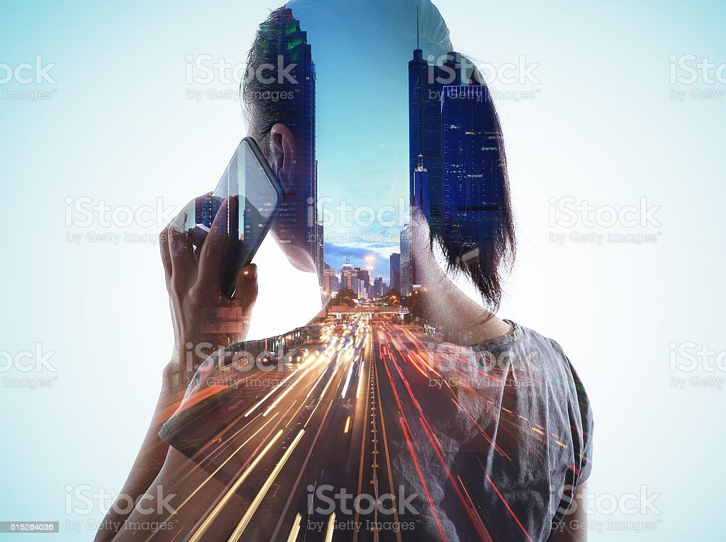 Double exposure of cityscape and smart phone stock photo
