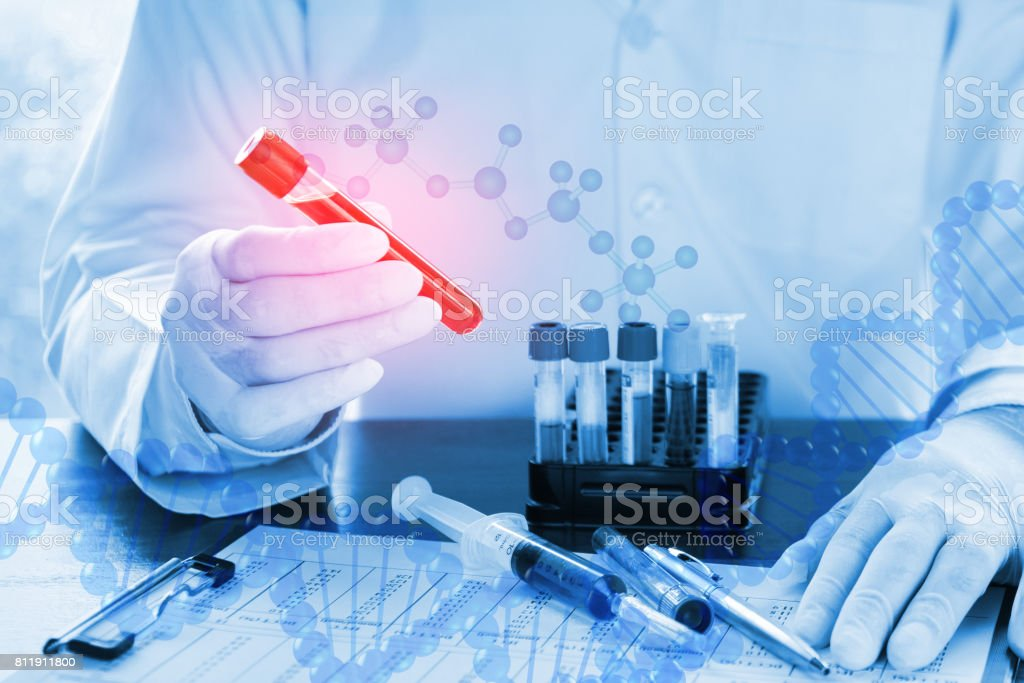Double exposure of close up of DNA testing of the blood stock photo