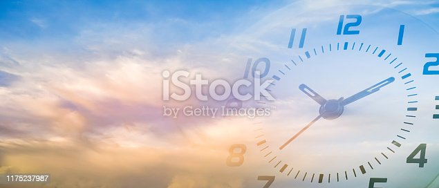 istock double exposure of cloudy sky and clock at ten o'clock ten minute , time passing concept 1175237987