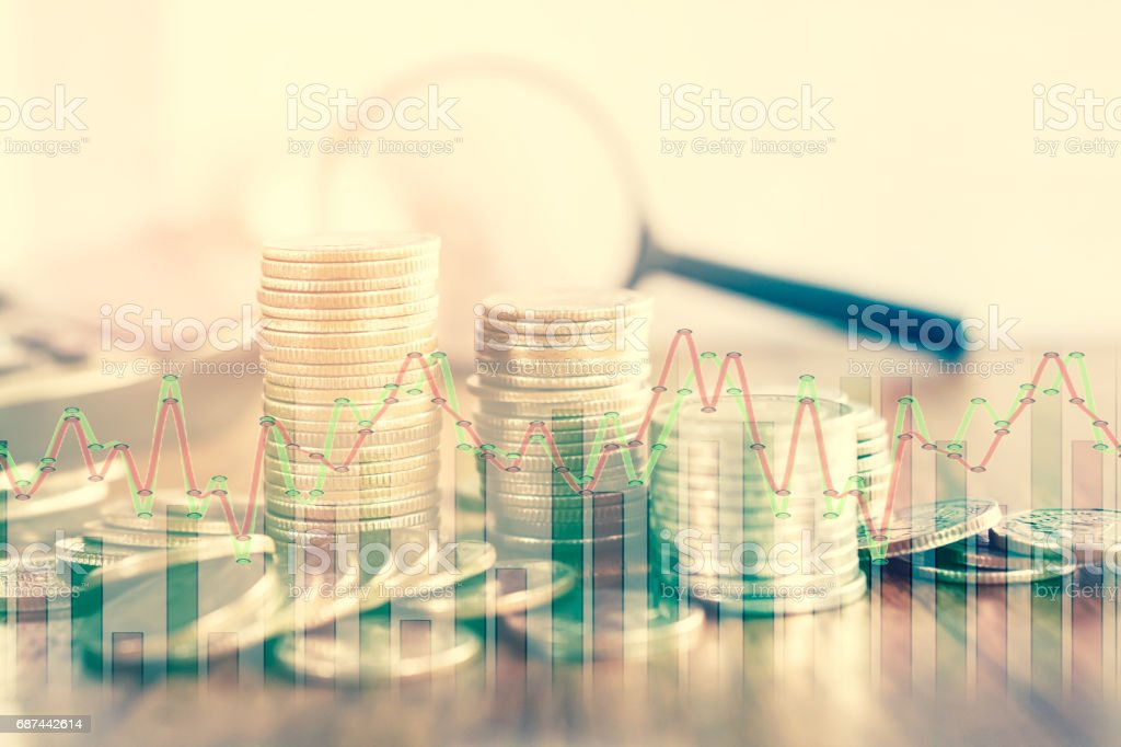 double exposure of coins and stock graph business concept in vintage tone stock photo
