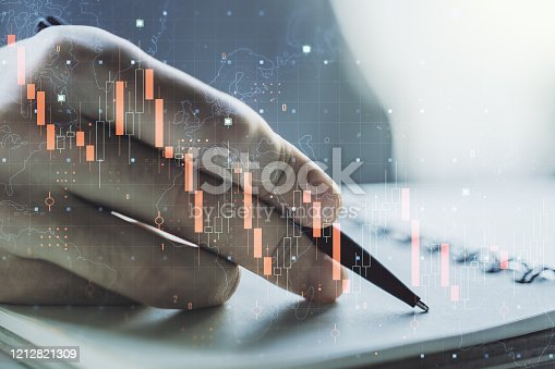 istock Double exposure of creative abstract global crisis chart with world map hologram and with hand writing in notebook on background. Financial crisis and recession concept 1212821309
