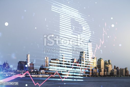 istock Double exposure of creative Bitcoin symbol hologram on New York city skyscrapers background. Cryptocurrency concept 1223290720