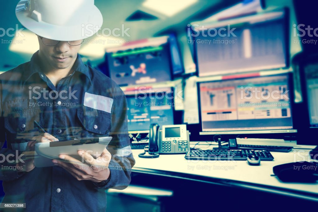 Double exposure of  Engineer or Technician man in working shirt  working with tablet in control room of oil and gas platform or plant industrial for monitor process, business and industry concept stock photo
