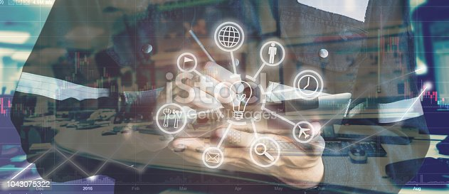917307226 istock photo Double exposure of Engineer or Technician man with business industrial tool icons while using tablet with monitor of computers room for oil and gas industry 4.0 business concept. 1043075322