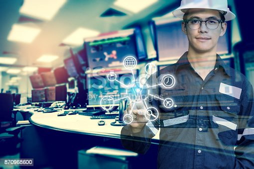 917307226 istock photo Double exposure of Engineer or Technician man with business industrial tool icons while pointing finger with monitor of computers room for oil and gas industrial business concept. 870968600