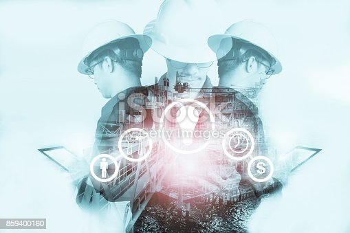 istock Double exposure of Engineer or Technician man with industry tool icons for management business by using tablet with safty helmet & uniform for oil and gas industrial business concept. 859400160